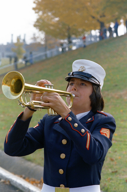 A woman Marine sergeant, who is a member of the band blows her trumpet, during a Marine Corps Birthday Pageant held in the stadium