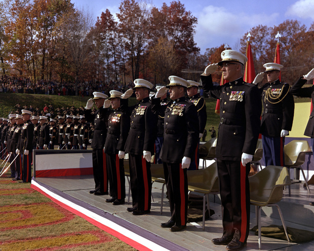 Former Commandant of the U. S. Marine Corps GEN Wallace M. Greene (second from left), is the guest of honor at a Marine Corps birthday pageant held in the stadium. To his left is LGEN Lewis J. Fields, commanding general