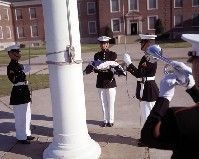 """The morning color guard detail stands at attention, as the trumpeter sounds """"Attention to Colors"""""""