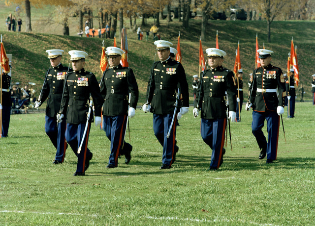 The staff of the Marine Corps Development and Education Command, march into position during a Marine Corps Pageant held in the stadium in honor of the 204th Marine Corps Birthday