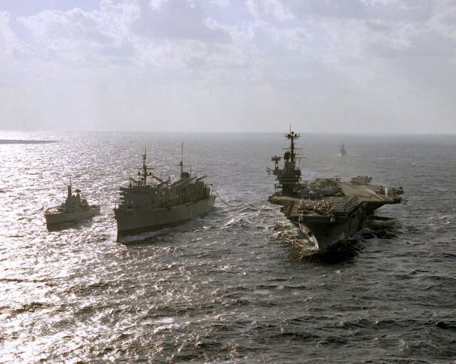 A view of the aircraft carrier USS INDEPENDENCE (CV-62), right, the fast combat support ship USS DETROIT (AOE-4), center, and the British frigate HMS SCYLLA (F-71) as the carrier is refueled by the support ship during a NATO exercise