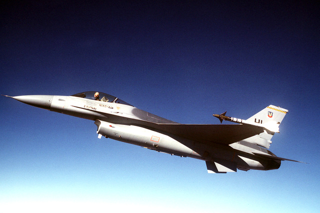 AN air-to-air left side view of an F-16 Fighting Falcon aircraft
