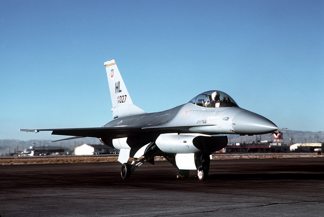 Front view of an F-16 Fighting Falcon aircraft from Tactical Fighter Weapons Center Det.1, parked on the flight line