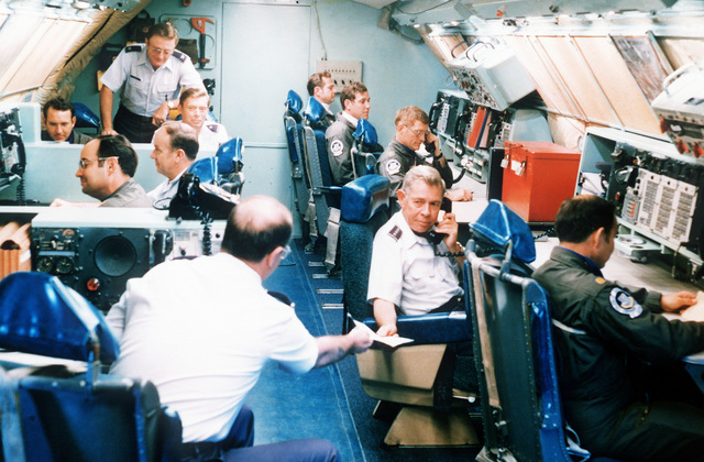GEN Richard A. Ellis, Strategic Air Command, commander in chief, handles top level communications in his airborne command post, during Exercise Global Shield '79