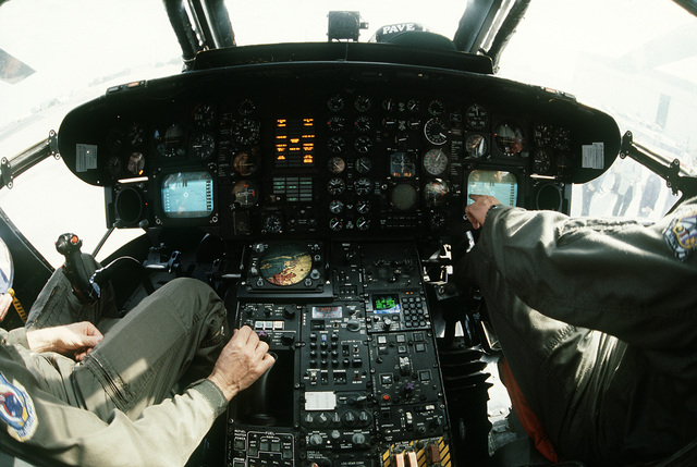 The pilot and co-pilot of this HH-53H Sea Stallion helicopter both have an infrared radar screen to monitor. This new system is called the Pave Low project. LT. COL. Frank Pehr, left, is the chief test pilot for this project