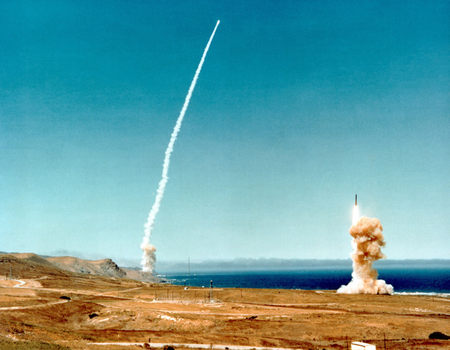 Two Minuteman III, intercontinental ballistic missiles are launched twelve seconds apart. This launching is part of the Strategic Air Command readiness Exercise, Global Shield 79
