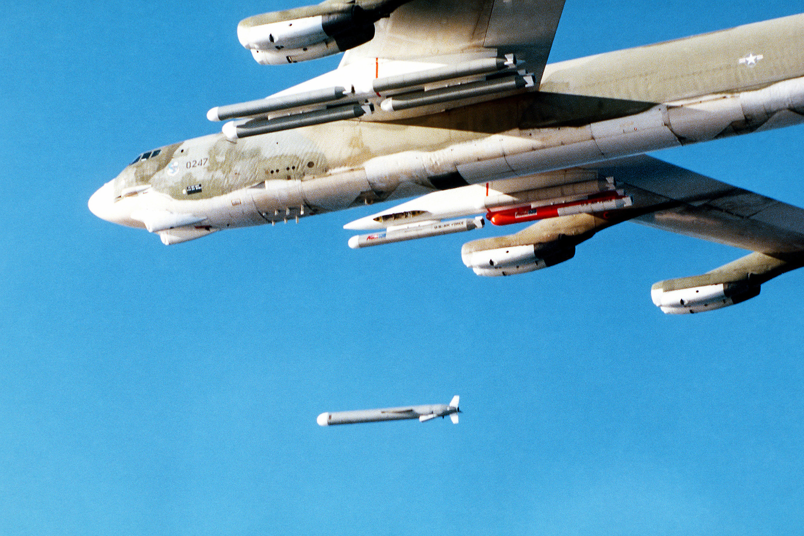 A left side view of a B-52 Stratofortress aircraft releasing an AGM-109 Tomahawk air-launched cruise missile