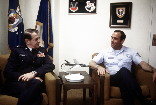 MSGT Wayne L. Fisk, right, talks with GEN Cornelius Nugteren, commander of the Air Rescue and Recovery Service (ARRS), at the ARRS Headquarters. Fisk has been selected as one of the 10 Outstanding Young Men of the Year by the United States Jaycees
