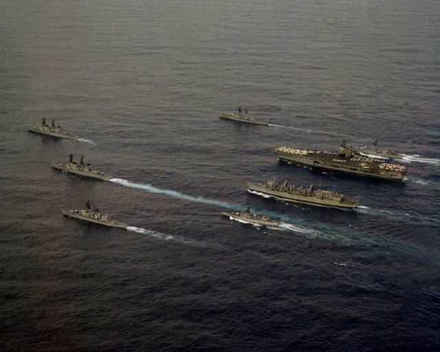 A port view of the USS INDEPENDENCE (CV-62) battle group as it heads home from deployment in the Mediterranean Sea. The ships are, clockwise from top, USS FARRAGUT (DDG-37), USS MCCANDLESS (FF-1084), USS INDEPENDENCE (CV-62), USS DETROIT (AOE-4), USS GARCIA (FF-1040), USS MAHAN (DDG-42), USS CARON (DD-970) and USS PETERSON (DD-969)