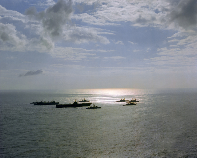 A starboard silhouetted view of the USS INDEPENDENCE (CV-62) battle group as it heads home from deployment in the Mediterranean Sea