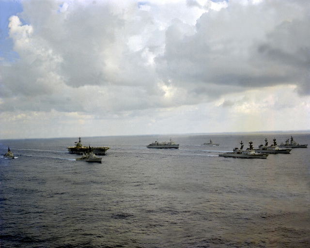 A starboard view of the USS INDEPENDENCE (CV-62) battle group as it heads home from deployment in the Mediterranean Sea. The ships are, clockwise from right, USS MAHAN (DDG-42), USS CARON (DD-970), USS PETERSON (DD-969), USS FARRAGUT (DDG-37), USS MCCANDLESS (FF-1084), USS INDEPENDENCE (CV-62), USS DETROIT (AOE-4) and USS GARCIA (FF-1040)