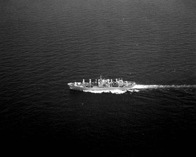 An aerial port beam view of the combat stores ship USS WHITE PLAINS (AFS-4) underway