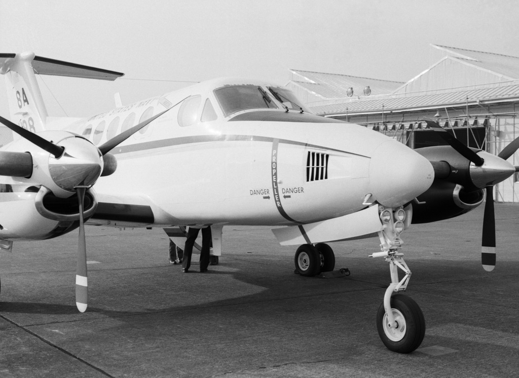 A right front view of the first UC-12B Huron aircraft to land at NAF Atsugi.  The plane was piloted by Captain (CAPT) Frederick W. Lawler and Lieutenant (LT) Gregory H. Bergh