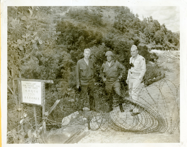 Representative Gerald R. Ford with Unidentified Military Personnel Standing Near the South Limit of the Demilitarized Zone in South Korea