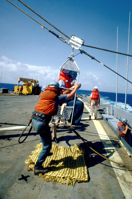 A boatswain's chair is pulled to the deck of the destroyer USS ARTHUR W. RADFORD (DD-968) during a personnel transfer by highline, from the guided missile destroyer USS KING (DDG-41). The ships are participating in exercise Unitas XXI