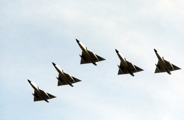 A bottom view of a five-ship wedge formation of F-106 Delta Dart aircraft during exercise William Tell '80