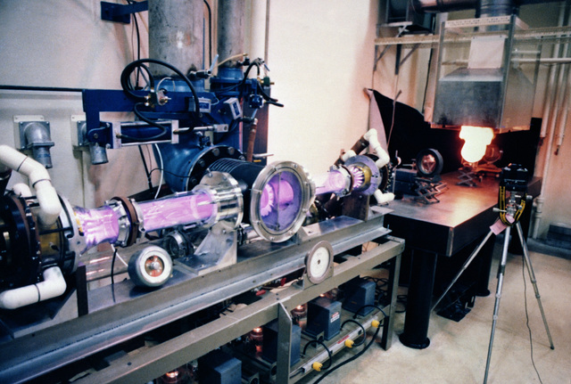 A carbon dioxide electric discharge laser burns a sheet of plexiglass at the Air Force Weapons Laboratory