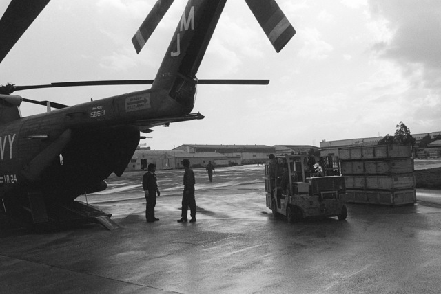 A forklift is used to load cargo aboard an RH-53D Sea Stallion helicopter from Fleet Logistics Support Squadron 24 (VR-24)