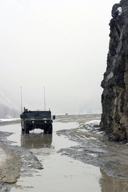 A High-Mobility Multipurpose Wheeled Vehicle (HMMWV) driven by U.S. Marines Corps personnel from a Weapons Company with the 3rd Battalion, 3rd Marine Regiment, head down a narrow stretch of road while in route to the Khowst-Gardez Pass in Afghanistan, on Dec. 28, 2004.  These Marines are conducting security and stabilization operations in support of Operation Enduring Freedom. (U.S. Marine Corps PHOTO by CPL James L. Yarboro) (Released)