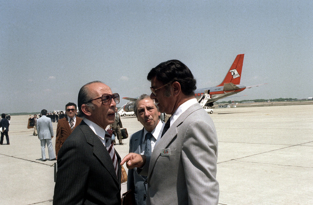 A Mexican Congress member talks with other VIPs upon his arrival in the United States for a visit