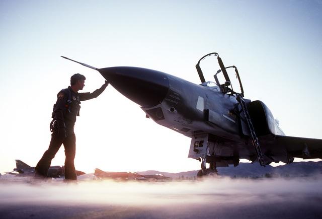 A pilot makes a preflight check on an RF-4C Phantom II aircraft. The pilot is from the 152nd Tactical Reconnaissance Group, Nevada Air National Guard