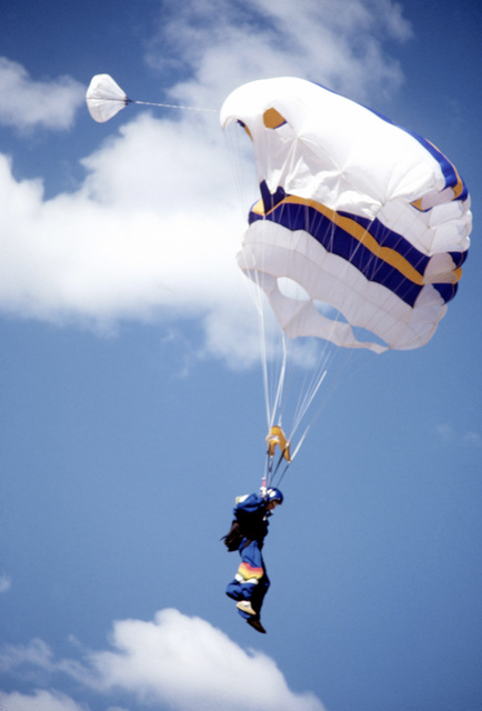 A United States Naval Academy parachute team member nears the ground during the 1980 Tri-Service Parachute Tournament