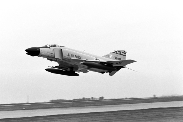 """A U.S. Air Force F-4D Phantom II aircraft assigned to the 119th Fighter Wing""""Happy Hooligans"""", North Dakota Air National Guard, takes off from the flight line at Hector International Field, in Fargo, N.D. (A3604) (U.S. Air Force PHOTO by TECH. SGT. David H. Lipp, 119th Communications Flight) (Released)"""