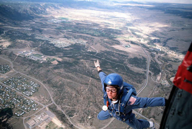 A USAFA Wings of Blue parachute team member 2nd Class Lori L. Fulton jumps off an Otter aircraft during the 1980 Parachute Tournament