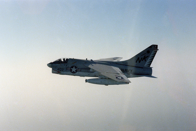 Air-to-air left side view of an A-7 Corsair II aircraft from Light Attack Squadron 27 (VA-27)