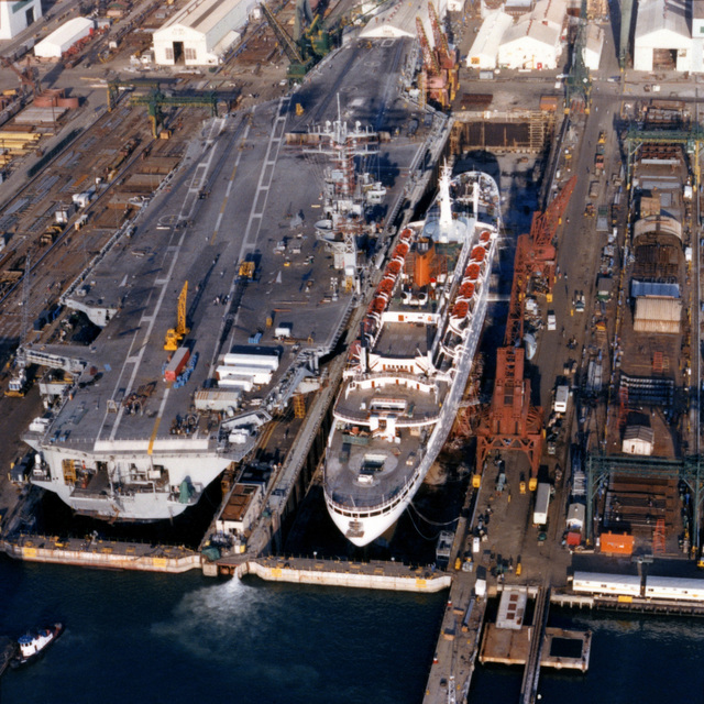 An aerial stern view of the nuclear-powered aircraft carrier CARL VINSON (CVN 70) under construction at Newport News Shipbuilding