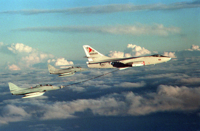 An EA-3B Skywarrior aircraft from Tactical Electronic Warfare Squadron Thirty-Three (VAQ-33) refuels TA-4J Skyhawks of Composite Squadron Twelve (VC-12) based at Naval Air Station Oceana, Virginia. Exact Date Shot Unknown