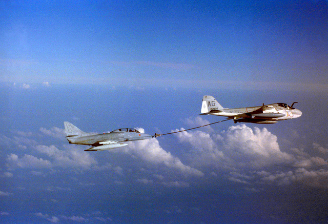 An KA-6B Intruder aircraft of Attack Squadron Forty Six (VA-46) refuels a TA-4J Skyhawk aircraft of Composite Squadron Twelve (VC-12). VC-12 is based at Naval Air Station Oceana, Virginia. Exact Date Shot Unknown