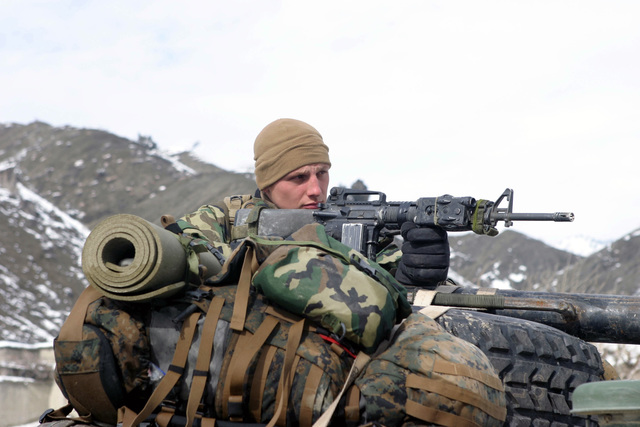 Armed with a Colt 5.56mm M16A2 Assault Rifle, U.S. Marine Corps Lance CPL. Chris Peck, a rifleman with Weapons Company, 3rd Battalion, 3rd Marine Regiment, provides security while on a long security halt in the Khowst-Gardez Pass, Afghanistan, on Dec. 29, 2004.  These Marines are conducting security and stabilization operations in support of Operation Enduring Freedom.  (U.S. Marine Corps PHOTO by CPL James L. Yarboro) (Released)