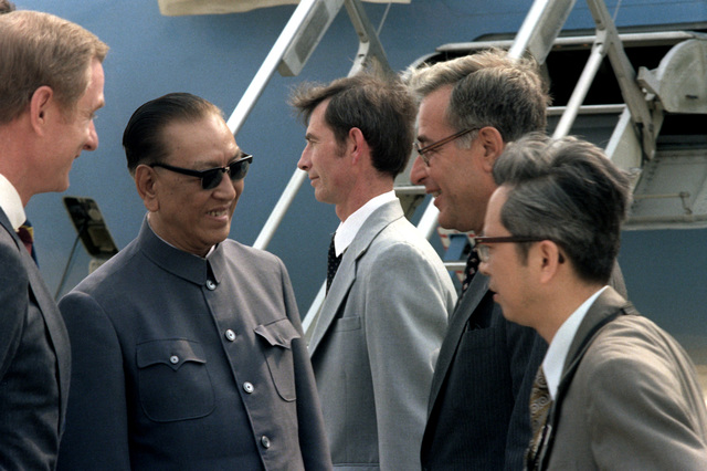 Chinese minister of Defense Geng Biao talks with Secretary of Defense Harold Brown and other VIPs on his departure from the United States after his visit