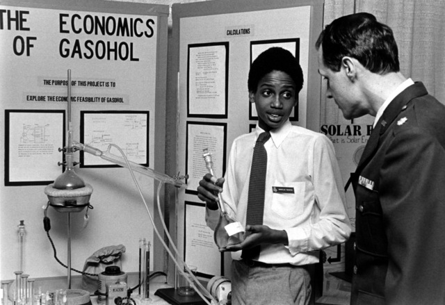 Douglas Thigpen, handicapped by dyslexia, explains his science project to judge MAJ. Robert E. Schuldt. Air Force judges coordinate in reviewing awarding regional science fair competitors. These rivals are junior and senior high school students who enter the 250 fairs, represented by Chicago's Museum of Science of Industry nationally