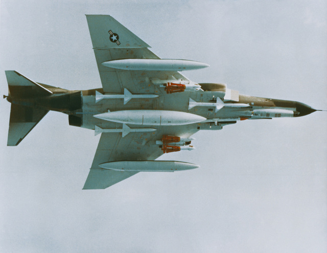F-4E Phantom II aircraft armed with three AIM-7 Sparrow missiles, an EROS pod, and four red-tailed AIM-4 missiles