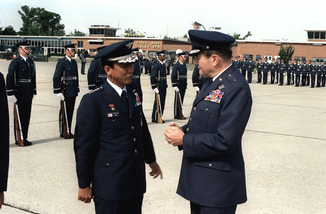 Korean air force GEN Eung Yul Yoon, right, talks with GEN Robert Mathis, U.S. Air Force vice chief of staff, before his departure from the United States after his visit