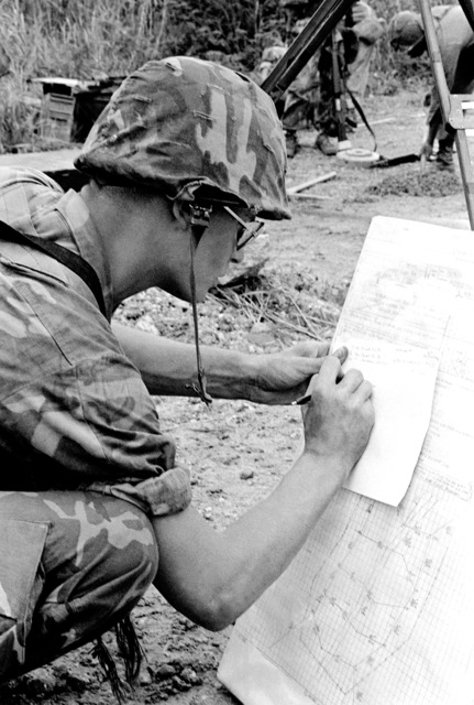 LCPL Terry Jackson keeps a record of the minefield his company is laying during their field training at the Central Training Area