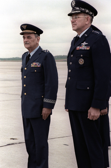 LGEN Leonardo T. Collaces, Brazil air force chief of staff, next to GEN Lew Allen, U.S. Air Force chief of staff, pays honor to the U.S. flag upon his arrival in the United States for a visit