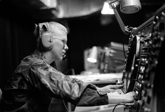 SGT Michael K. Lahammer is a member of Headquarters and Headquarters Squadron 18 and has the job of tracking all approaching aircraft by using a headset and equipment with a status display screen