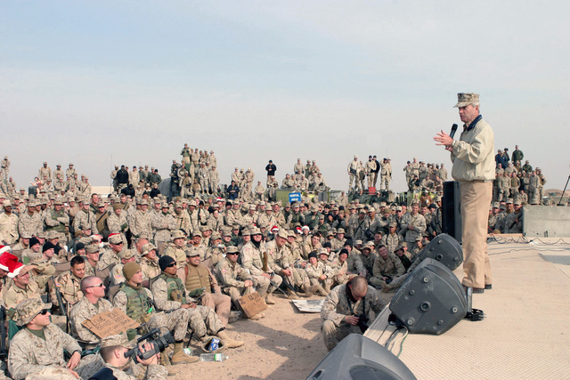 Stand-Up Comedian Thomas Dreesen performs for US Army (USA) Soldiers, US Marine Corps (USMC) Marines, and US Navy (USN) Sailors as part of David Letterman's 2004 Happy Holidays visit to Taqaddum, Al Anbar Province, Iraq, to entertain US military service members stationed in Iraq during Operation IRAQI FREEDOM
