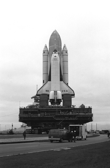 The space shuttle Columbia and its rockets move toward the launch pad aboard the portable launch platform