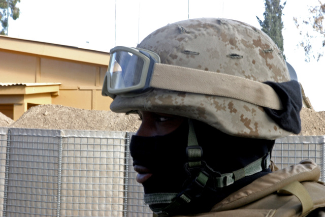 U.S. Marine Corps CPL. Phil Green, Food Service Specialists, assigned to Headquarters and Service Company, 3rd Battalion, 3rd Marine Regiment, wears his cold weather mask, before a patrol at Forward Operating Base Salerno, located in the Province of Khowst, Afghanistan on December 7, 2004. U.S. Marine Corps, 3rd Battalion, 3rd Marine Regiment Marines are conducting security and stabilization operations in Afghanistan, in support of Operation Enduring. (U.S. Marine Corps photo by Lance CPL. James L. Yarboro) (Released)