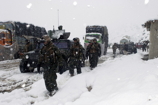 U.S. Marine Corps personnel with Weapons Company, 3rd Battalion, 3rd Marine Regiment, provide security for a convoy during a long security halt in a mountain village, at the Khowst-Gardez Pass, Afghanistan, on Dec. 31, 2004.  These Marines are conducting security and stabilization operations in support of Operation Enduring Freedom.  (U.S. Marine Corps PHOTO by CPL James L. Yarboro) (Released)