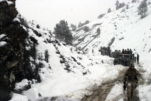 U.S. Marine Corps troops in High-Mobility Multipurpose Wheeled Vehicles (HMMWV) of Weapons Company, 3rd Battalion, 3rd Marine Regiment, conduct a mounted patrol in the cold and snowy weather of the Khowst-Gardez Pass, Afghanistan, in order to disrupt any enemy activity on Dec. 30, 2004.  The Marines are stuck in heavy snow and had to move on foot.  These Marines are conducting security and stabilization operations in support of Operation Enduring Freedom.  (U.S. Marine Corps PHOTO by CPL James L. Yarboro) (Released)