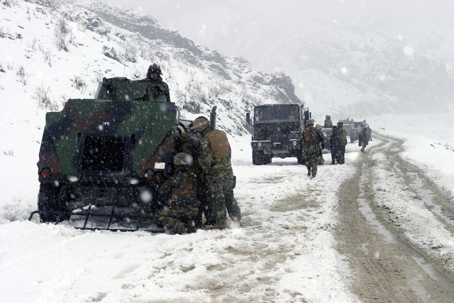 U.S. Marine Corps troops in High-Mobility Multipurpose Wheeled Vehicles (HMMWV) of Weapons Company, 3rd Battalion, 3rd Marine Regiment, conduct a convoy patrol in the cold and snowy weather of the Khowst-Gardez Pass, Afghanistan, in order to disrupt any enemy activity on Dec. 31, 2004.  These Marines are conducting security and stabilization operations in support of Operation Enduring Freedom.  (U.S. Marine Corps PHOTO by CPL James L. Yarboro) (Released)