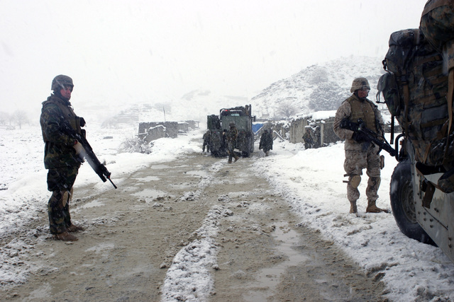 U.S. Marines Corps personnel from a Weapons Company with the 3rd Battalion, 3rd Marine Regiment, head down a narrow stretch of road while in route to the Khowst-Gardez Pass in Afghanistan, on Dec. 28, 2004.  These Marines are conducting security and stabilization operations in support of Operation Enduring Freedom. (U.S. Marine Corps PHOTO by CPL James L. Yarboro) (Released)