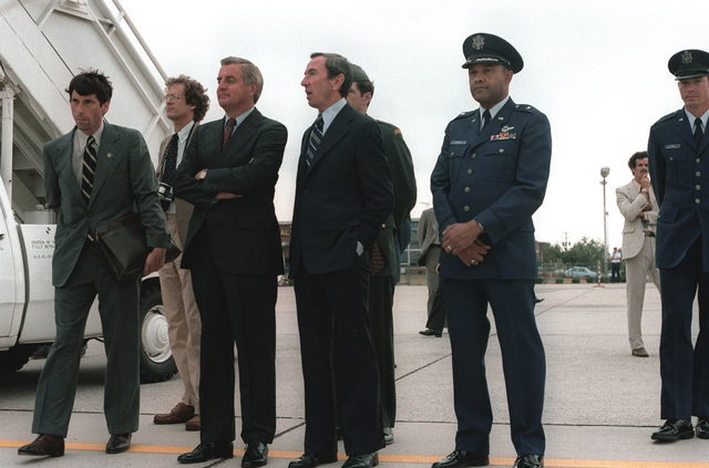 Vice President Walter Mondale and BGEN Archer L. Durham, first on right, Military Traffic Management Command vice commander, wait as President Jimmy Carter returns from his European visit
