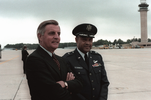 Vice President Walter Mondale and BGEN Archer L. Durham, Military Traffic Management Command vice commander, wait for the return of President Jimmy Carter from his European visit