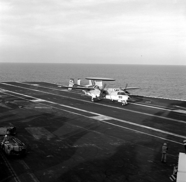 A right front view of an E-2C Hawkeye airborne early warning aircraft from Airborne Early Warning Squadron 113 (VAW-113) assigned to Carrier Air Wing 3 (CVW-3) landing on the flight deck of aircraft carrier USS SARAGTOGA (CV-60) underway off the coast of Florida
